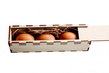 Tree fresh brown eggs in wooden handmade box