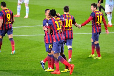 F.C. Barcelona players celebrate a goal