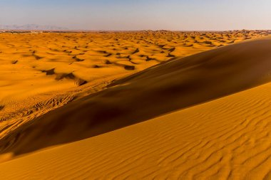A view across the red desert at Hatta near Dubai, UAE in springtime
