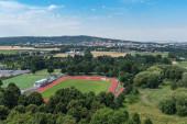 Blick vom Schloss Friedberg auf eine Sportanlage und die Stadt Bad Nauheim, Hessen