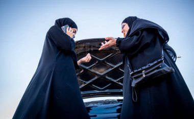 Arabic women car having problem in the street