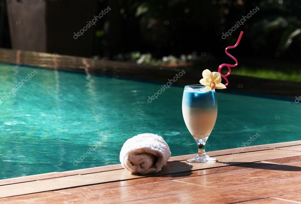 One blue exotic cocktail by the pool