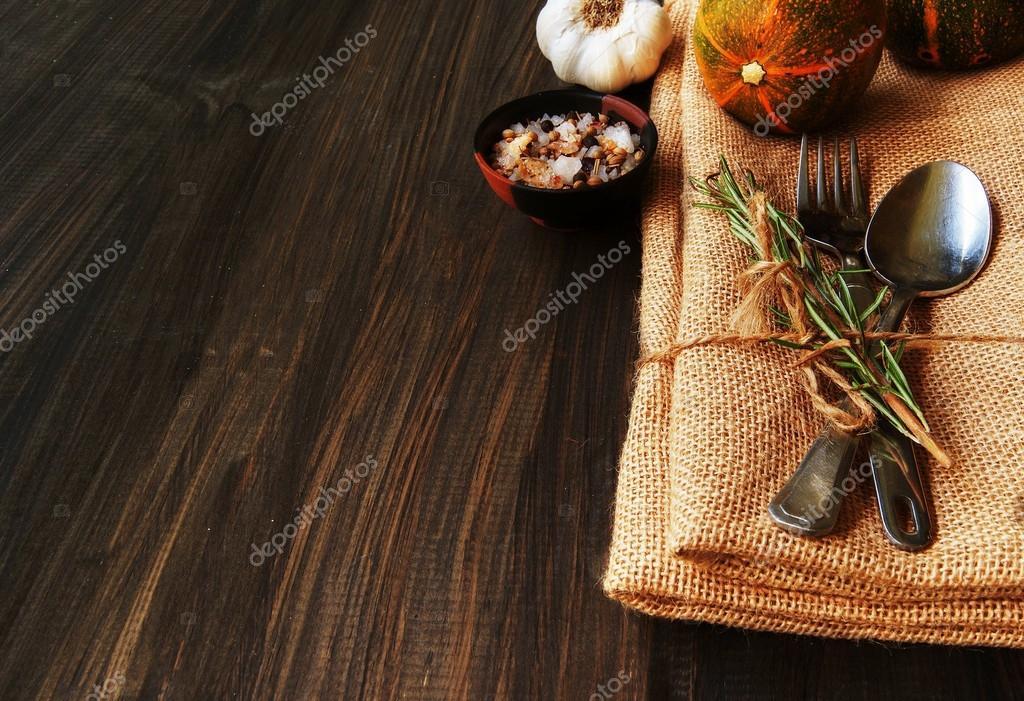 Seasonal table setting with small pumpkins