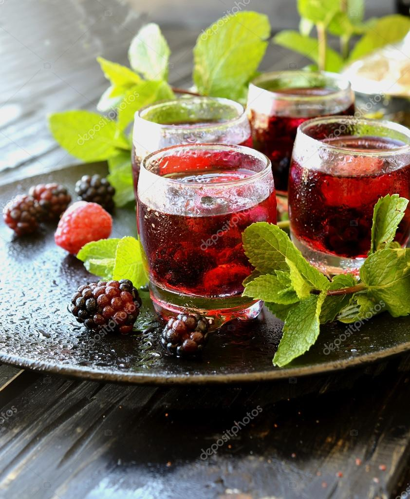 berry juice in a glass with berries, selective focus