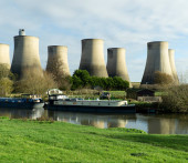 Long barge moored near a power station