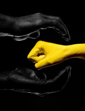 Black and yellow hands