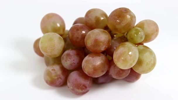 A bunch of grapes in close-up on a white background. Turntable. Selective focus.