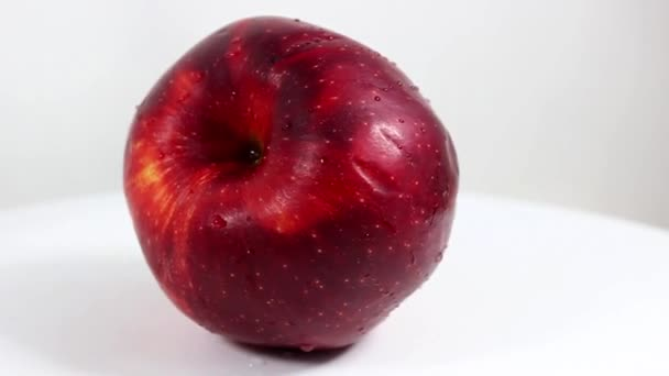 One big red apple close-up. Turntable. Selective shot.