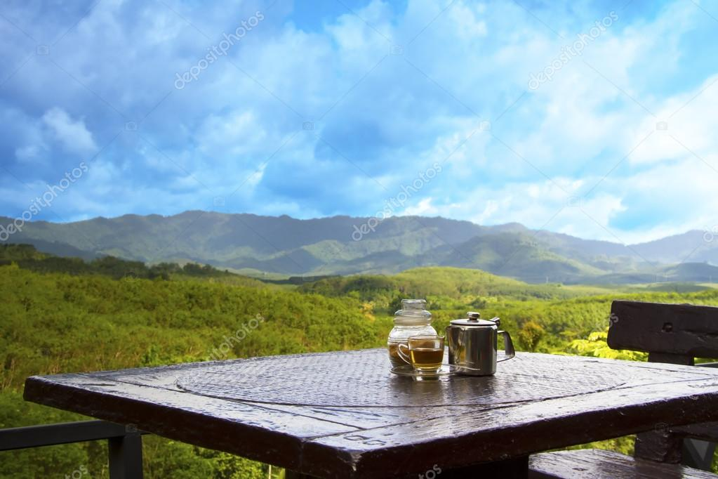 Coffee and mountains and blue sky
