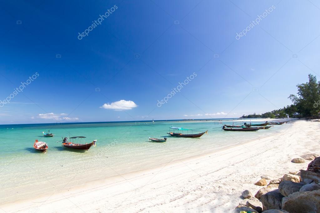 long-tailed boat at the beach and blue sky at Koh Phangan,Sura