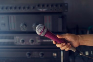 microphone in woman hand on backstage of concert