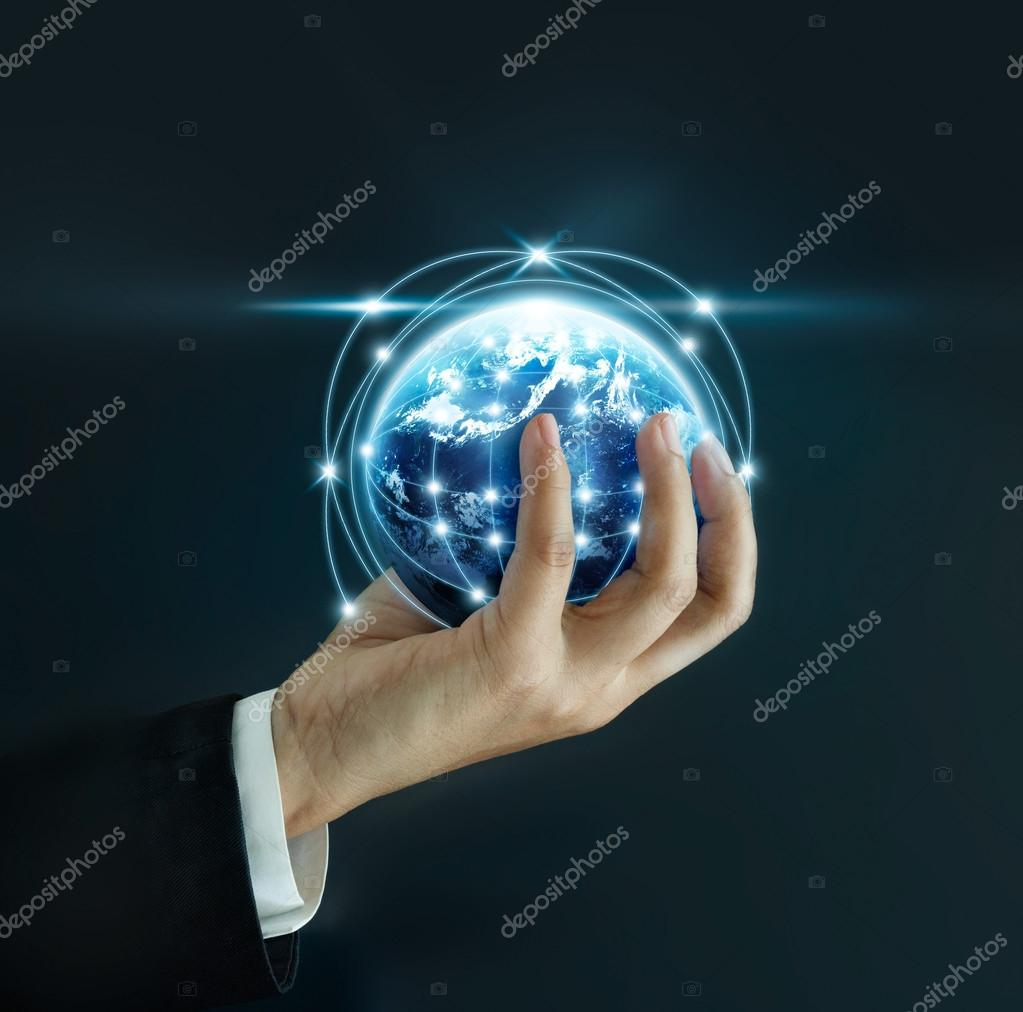 Business man holding the small world in hands on dark background