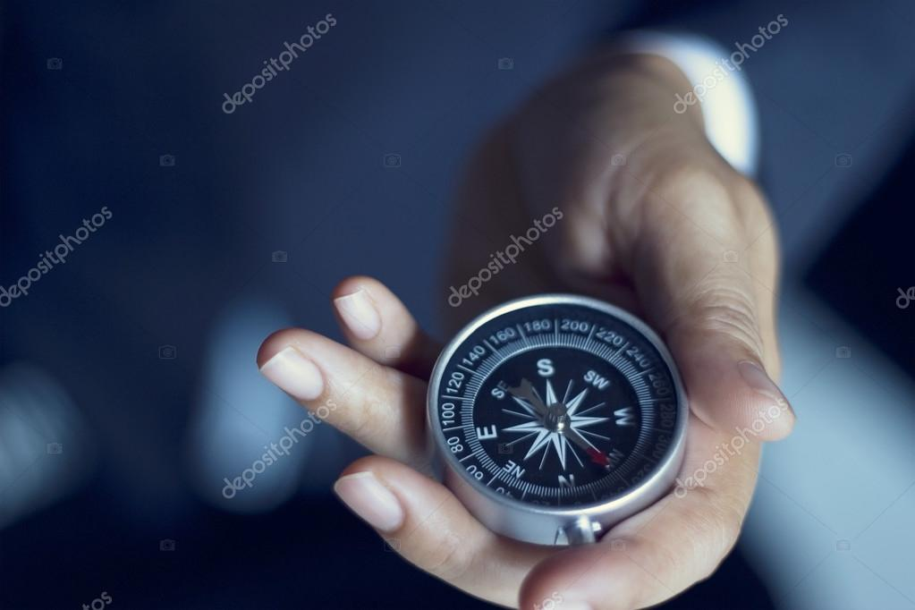 leader of businessman show the compass in hand, business concept