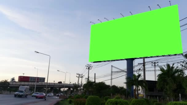 Time Lapse of Blank Billboard with a Green Screen on Night Street with light trails, city night background.