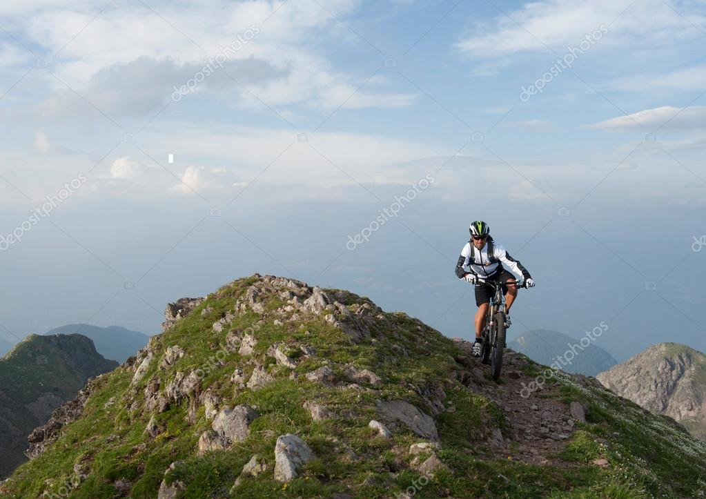 mountainbike uphill on mountain ridge