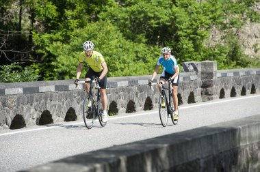 two road bikers by uphill