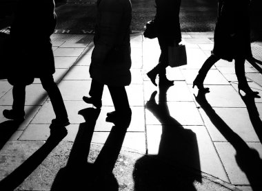 Silhouettes of legs walking