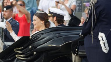Rear view of the swedish Prince Carl-Philip Bernadotte and his w