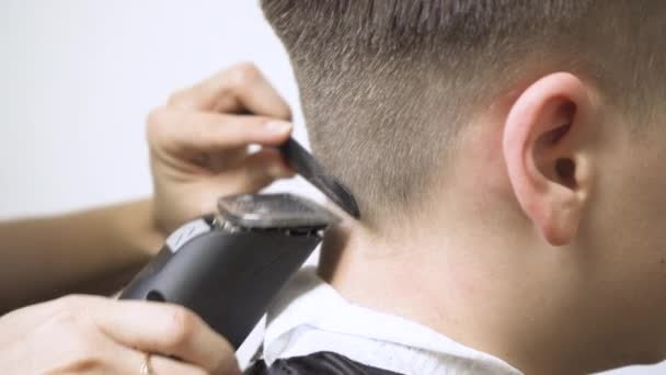 Close-up of hair clipper on the back of the head with a hair clipper.