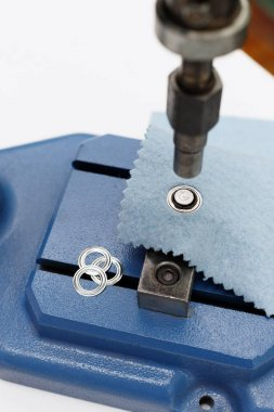 machine for rivets and buttons in sewing production