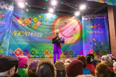 Maslenitsa (pancake week). The host announces the beginning of the competition.