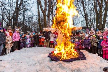 Maslenitsa (pancake week). Burning the effigy of Winter, surrounded by people.