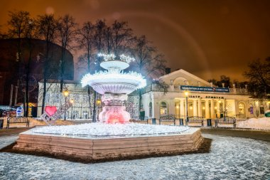 The fountain with lights on the background of the Hermitage Thea