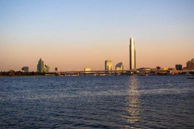 Dubai creek golf and yacht club, park hayatt hotel, D1 tower and other landmarks of Dubai.