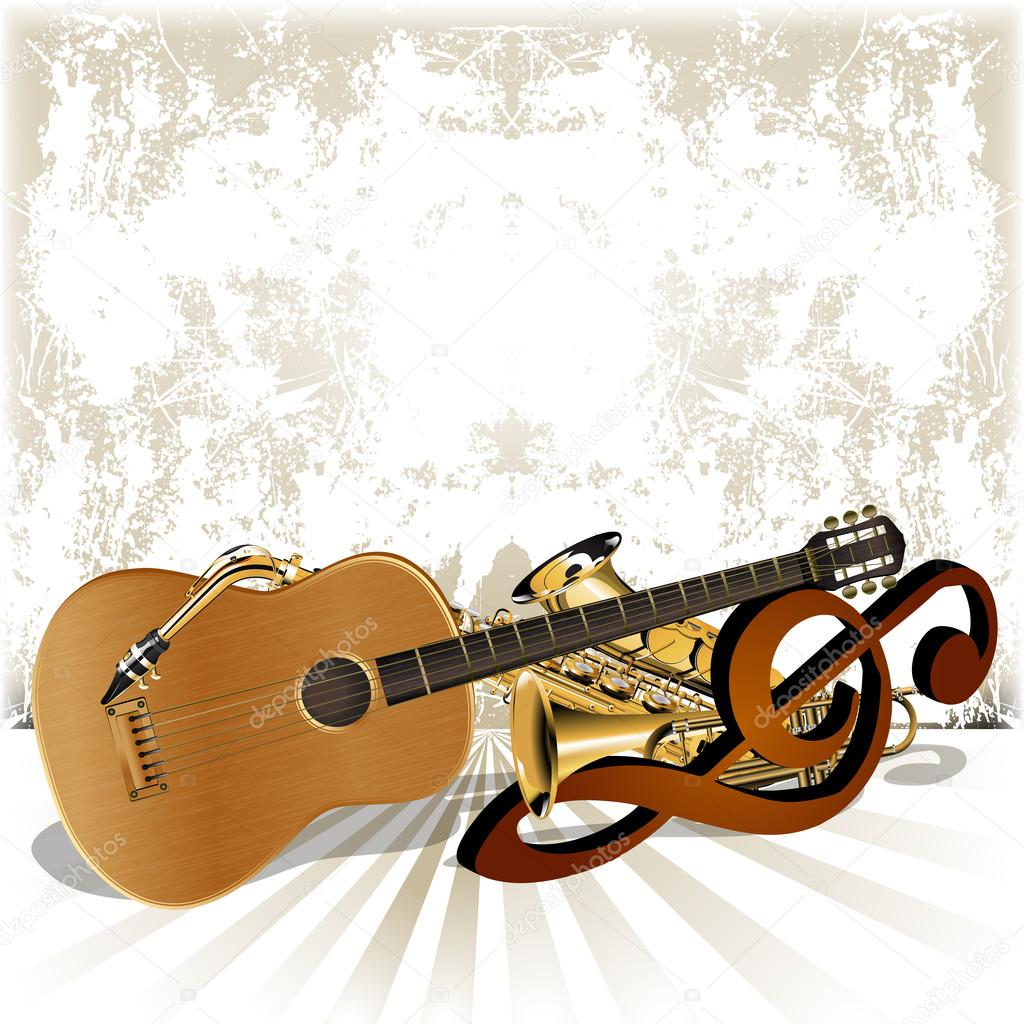 Acoustic guitar rests on the treble clef trumpet and saxophone ...