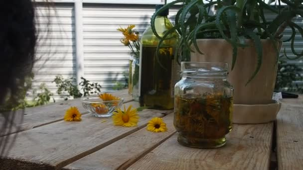 Herbs, bottles on wooden background. Alternative Medicine, Natural Healing.