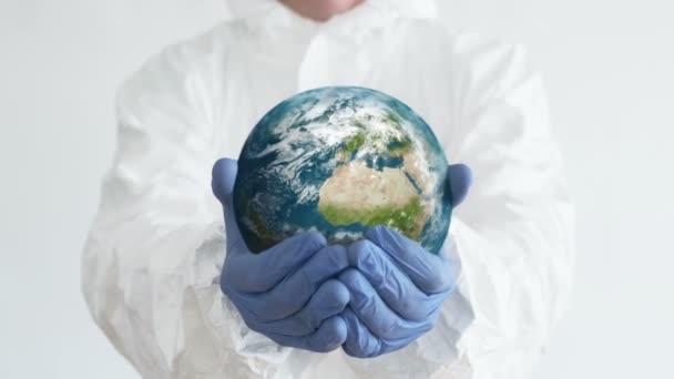 Planet in Doctors Hands. Close-Up Shot. Coronavirus Concept