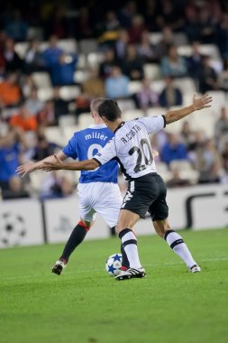 Ricardo Costa (R) and Kenny Miller (L) during the game