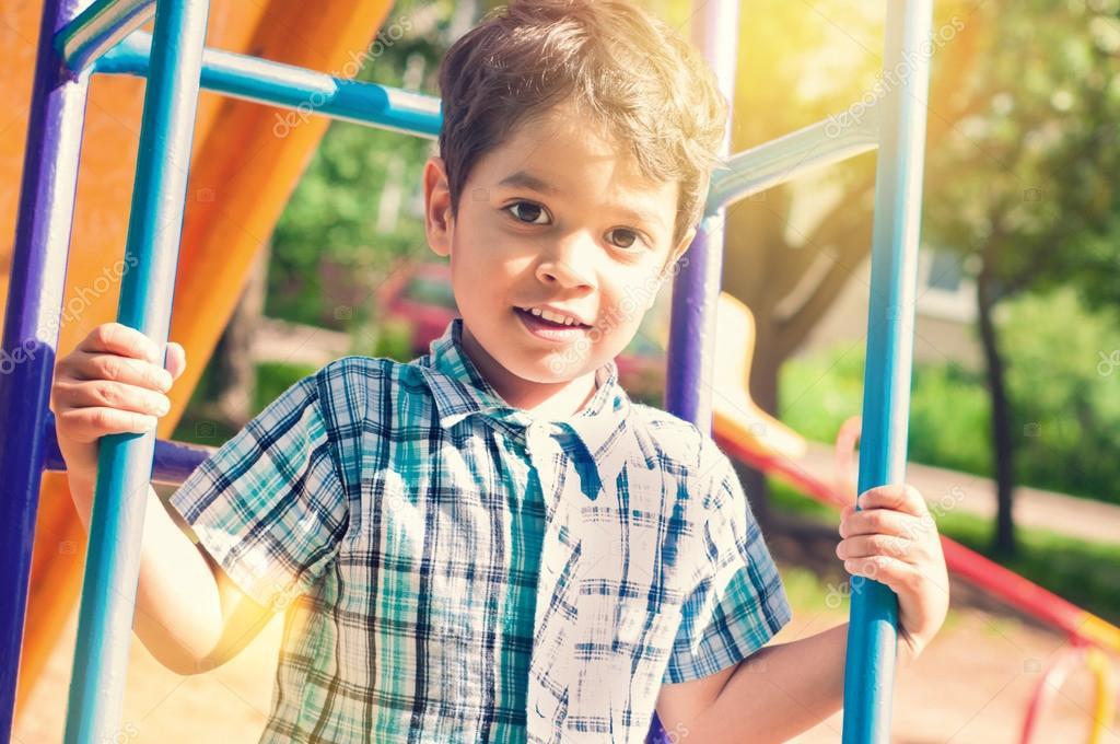 Portrait of a little indian boy outdoors