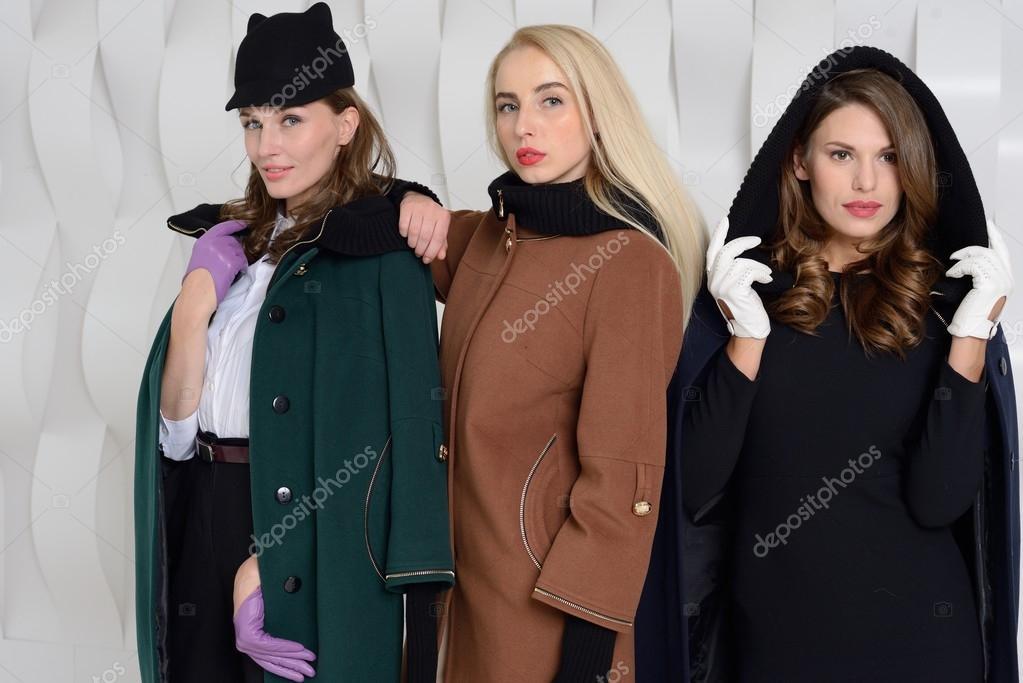 7dc0f7c16 Girls in studio posing at coats — Stock Photo © Ellya  100817938