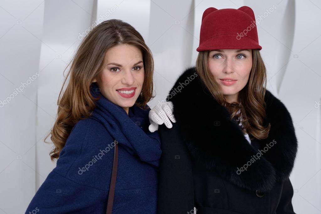 7a852e091 Girls in studio posing at coats — Stock Photo © Ellya  100819924