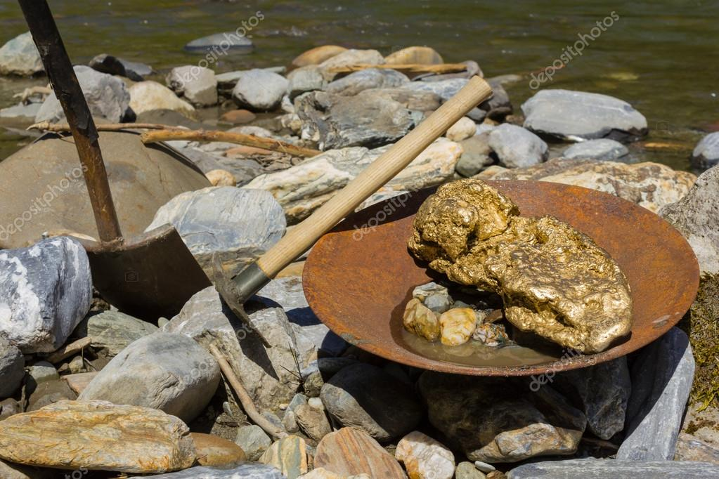 Gold Nugget Mining From The River With A Pan And Find Some Big Photo By Luftklick