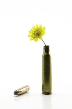 shotgun shell with yellow little flower