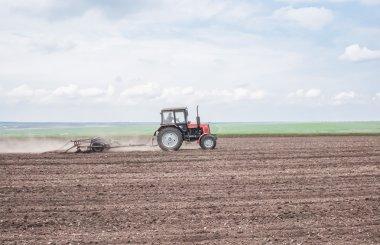 Tractor plowing a field. Ukraine, mikolayev region stock vector