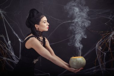 Halloween costume wicked witch and her magic potion