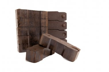 Coal with two carbon bricks on white background