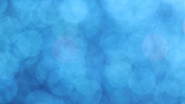 Modrý bokeh postupuje na pozadí