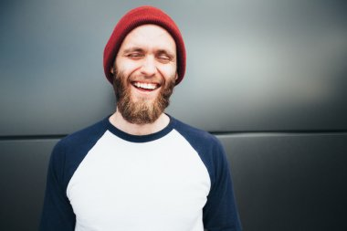 Hipster man smiling and wearing a hat