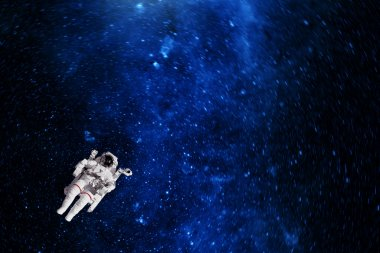 Astronaut in outer space against the planet earth. Elements of t