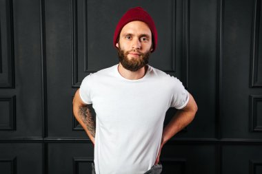 White blank t-shirt with space for your logo on a hipster man wi