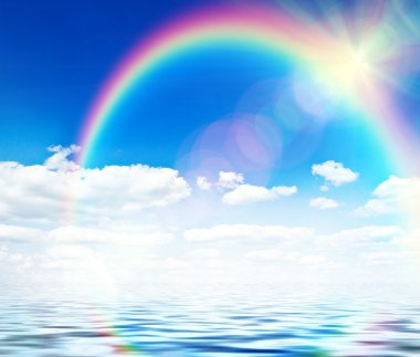 Blue sky background with rainbow