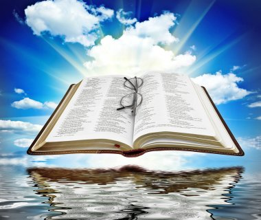 Book with blue sky and white clouds