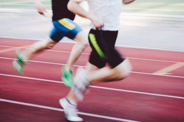 Athletes running on track