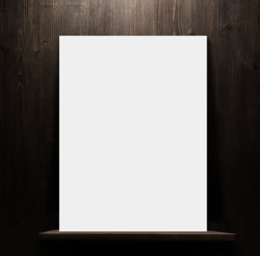 Wooden shelf with blank poster