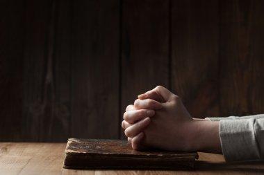 Hands folded in prayer