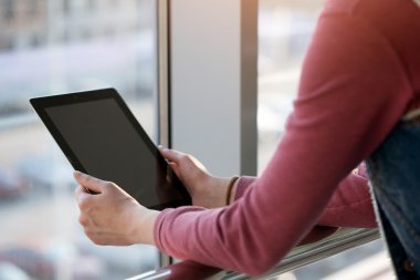 Woman using tablet pc outdoors